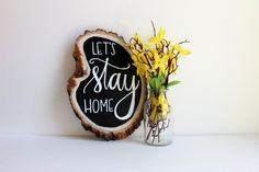 """""""Lets Stay Hoe (Option2)"""" Chalkboard Wood Slice Sign  Wood slices measure around 8-9 inches wide and 10-12 inches long. Each wood slice is unique and will vary in size and shape. Designs are hand written with chalk marker and then sprayed with a protective sealant. Because each piece is custom made the colors and appearance may differ slightly from listing images.  • Saw tooth hangers are NOT included but if you would like us to add one to your order, please comment in the note to seller box…"""