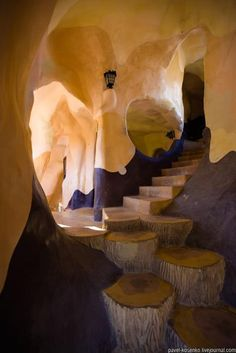 creative use of stumps for stairs and I love the free-form wall sculpting.