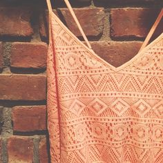 NWT Peach Romper New with tags peach colored romper from Forever 21. Size medium. Criss cross straps. Cute crochet detail! Forever 21 Pants Jumpsuits & Rompers