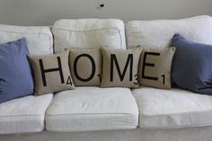 "Spell it out! Set of 4 letter pillows spelling ""HOME"".  Materials: Heavyweight taupe decorator fabric, black wool felt  Size: 12"" x 12"" pillow.  14"" x 14"" poly-fil pillow forms. Envelope closure in the back."