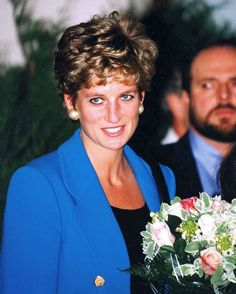 28 November 1994: Diana, Princess of Wales, at the Enfant Present Creche, a nursery in Paris, France.