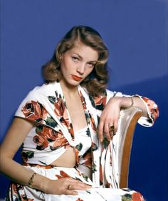 Lauren Bacall posing in a fabulous floral dress. #modcloth #styleicon