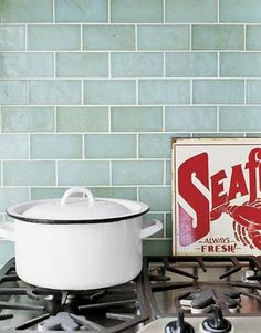 Kitchen Backsplash Option. Love the vintage sign and old enamelware stockpot!