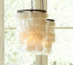 Capiz Chandelier - draped with tiers of natural capiz shells, this chandelier mellows and warms the light...