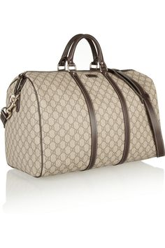 Taupe and mushroom 'GG'-stamped canvas Two top handles, detachable adjustable shoulder strap Brown leather trims (Calf), pale-gold hardware Internal zip-fastening pocket Fully lined in taupe canvas Zip fastening along top Comes with dust bag Gucci Purses, Gucci Handbags, Canvas Weekender Bag, Tote Bag, Handbag Accessories, Fashion Accessories, Gucci Monogram, Boston Bag, Monogram Canvas