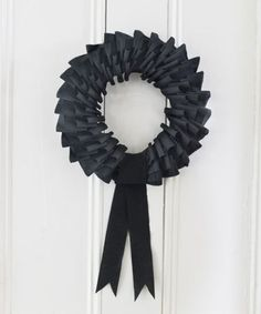 "Too cute. Too easy. Too cheap. It's just crepe paper streamers, cut in 4"" long strips, then folded & pinned to your foam wreath form. This black is great for Halloween, but ANY color works depending on the theme. Cute in bright colors on a bday boy/girl's door. Team colors for a party, etc."