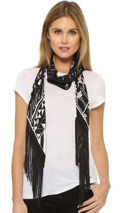 A surreal print and voluminous strands of fringe lend a statement-making look to this thin Rockins scarf.