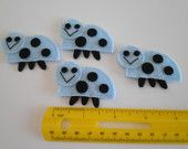 Set Of 4 Handmade Felt Ladybug Appliques  - Two Inch Size In baby blue & black - for hair, crafts and more