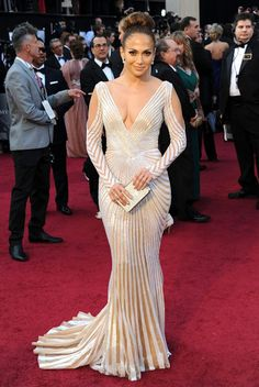 No No No. One of the worst dress this year. Jennifer Lopez  In custom Zuhair Murad couture with aSalvatore Ferragamomirrored clutch.