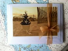 Holiday Series III from The Coastal Collection consists of six hand-crafted, assorted coastal holiday cards and envelopes. Wrapped in a clear sleeve and adorned with a gold organza bow.  https://www.etsy.com/listing/160811540/holiday-iii-series-card-set-by-the?ref=related-4