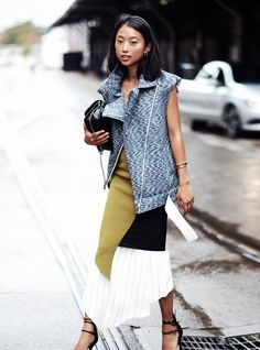 Margaret Zhang in a color-block dress and oversized moto vest