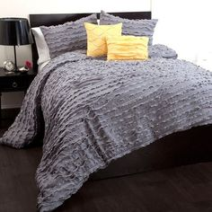 "Lush Decor Modern Chic 5-Piece Comforter Set, Full, Gray by Lush Decor. $149.99. 5-pc set includes: One comforter, two pillow shams, and two dec. pillows. Care Instructions: Comforter/shams: dry clean * Pillows: spot clean. 250 GSM Comforter. Comforter: 78""W x 88""D. Fabric Content:100% Polyester. Cascades of soft gray ruffles highlighted by silver trim on the edges create a look that is contemporary and so stylish. With 2 shams that serve as a backdrop for the highly styled y..."
