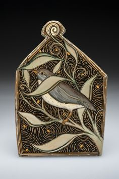 "Terri Kern. Birdsong and Wind, $225. Inspired by the poetry of Richard Hague, this intimate wall piece is hand crafted from a slab of clay and is part of my ""Icon"" series. This clay panel is ready to hang on the wall with the hanging piece already attached and bump-on pads on the back to protect your wall. size: 5"" x 3 1/2"" x 1/4"""
