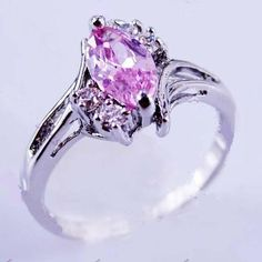 'size 8 Pink Sapphire White Gold Filled Ring' is going up for auction at  4pm Wed, Sep 19 with a starting bid of $7.