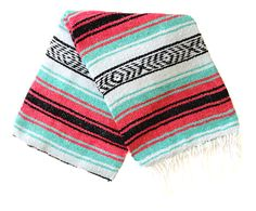 This is an authentic Mexican blanket in beachy pastel colors... perfect for the beach, picnic or as a bright home accent.Blanket colors: Sea foam/mint/turquoise, pink/magenta, black