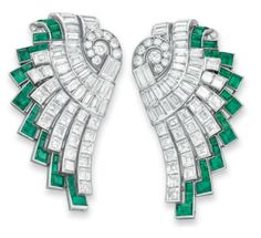 A PAIR OF ART DECO DIAMOND AND EMERALD CLIP BROOCHES, BY HENNELL   Each designed as a circular and baguette-cut diamond scalloped plaque, extending a graduated baguette-cut diamond fringe, bordered by rectangular and square-cut emeralds, mounted in platinum and white gold, circa 1930