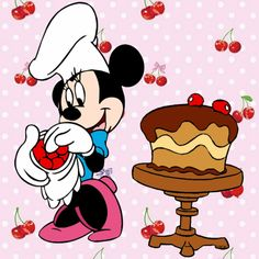 Minnie has her chocolate cake almost done and topping it off with some cherries.