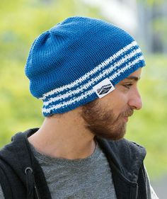 Mount Academy Hat - Free Pattern: Crisp white and bright blue team up effectively in this casual hat knit in Schachenmayr Catania Grande.