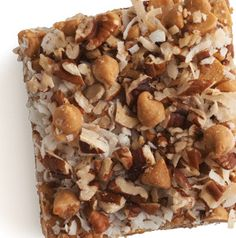 Seven-Layer Bars really have 7 layers. Start with melted butter spinkled with graham cracker crumbs and then load on the coconut, chocolate chips, butterscotch chips, chopped walnuts and the part that makes the whole thing go ooey-gooey, sweetened condensed milk.