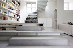 Stair Filled with Books by Smoothcore Architects in Paris, France_Arhitektura+