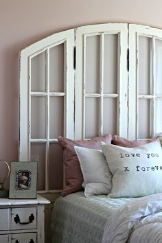Love this shabby chic window headboard.