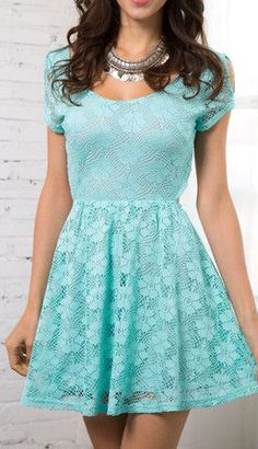 Model in lace cutout skater dress with back showing