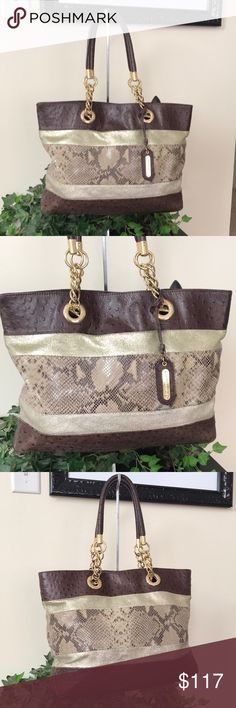 CYNTHIA ROWLEY BROWN MULTI COLOR TOTE🌸 CYNTHIA ROWLEY GORGEOUS ONE OF A KIND MULTI COLOR AND TEXTURES CHOCOLATE BROWN LARGE TOTE BAG WITH LIGHT AND DARK TONE GOLD ACCENTS. GOLDTONE HARDWARE THAT HAS SOME USAGE MARKS ON THEM. ROLLED LEATHER HANDLES WITH CHAIN SHOULDER STRAPS. INSIDE IS LARGE AND ROOMY, NO STAINS. PRE LOVED CONDITION. I TAKE GREAT CARE OF ALL MY BAGS. MEASUREMENTS BELOW. THIS ONE IS HARD TO LET GO OF.🌸 THIS IS A PRE LOVED TOTE. AL MEASUREMENTS BELOW. 💕 Cynthia Rowley Bags…