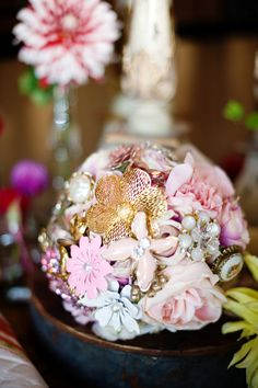 Brooch Pomander for Decor (or #bouquet !) | See this detail-rich wedding on #SMP Weddings:  http://www.stylemepretty.com/2013/12/19/russell-crossroads-wedding/  Photography: Simple Color