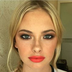 Perfect look for a spring wedding. Loving the orange lips.
