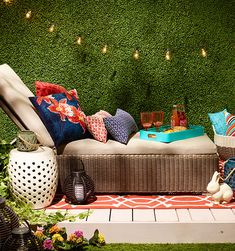 Create an outdoor oasis with a chaise lounge, pillows and more.