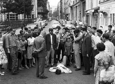 jean-luc godard and company during the final scene of À bout de souffle