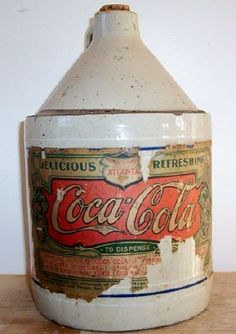 *COCA-COLA ~ An original ceramic jug w/ original label from Atlanta. THIS JUG IS EXCEPTIONALLY RARE: coke was originally sent out to stores as a syrup, before it was marketed in botles, about 1906.