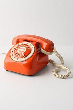 Orange rotary phone. #Retro