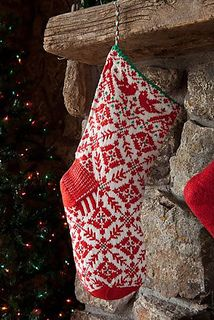 Worked in bright white and red, the Snow Bird Stocking is a traditional piece inspired by Nordic decorative arts. Birds perch at the top of the stocking, above a field of stars and vines; the stripes on the back side of the stocking are an abstract rendering of bird prints in the snow.