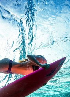 Surf girl in blue sea