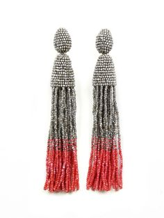 CLASSIC LONG OMBRE TASSEL EARRING - Oscar de la Renta $395.00 First spotted on the runway and a favorite among the fashion set, these long beaded ombré tassel earrings are sophisticated and glamorous. Designed in New York and handmade in India, these statement makers are a beautiful addition to any wardrobe. For the ultimate statement, wear with the hair swept to the side.