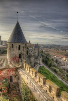 Carcassonne, France ~The beautiful view of the castle's ramparts and the city below.