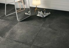 Strada Tile from Nemo Tile in the darkest gray called Cold.  Made to look like real poured cement, nice clean industrial appeal.
