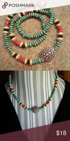 """NEW!  Wooden Beaded Necklace/Bracelet This pretty necklace was handcrafted by a local Native American woman I met at a wolf sanctuary.  Elastic cord also allows it to be wrapped as a bracelet.  20"""" long.  NWOT.   BUNDLE FOR THE BEST DISCOUNT!  No Trades, no PP, no off-site sales.  Please consider Poshmark's fee when making offers. Thanks. Jewelry Necklaces"""