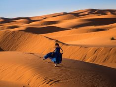 "Photograph by Logan Swayze, ""Free to Fly""  selected for National Geographic Your Shot photo of the day.  Swayze explains his inspiration from visiting Morocco with his wife: ""We absolutely fell in love with the simplicity of the landscape, and I wanted to capture the feeling of freedom the Sahara offers its guests,"" he writes. ""This image represents just that for me—freedom—a woman running, almost taking flight [within] the infinity of the landscape."""