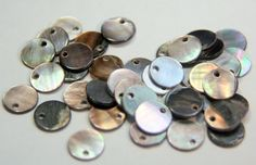 20 shell mother of pearl round disks by debsdesigns401 on Etsy, $3.10