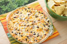 This Hot Black Bean & Corn Dip is sure to be a hit at any party and uses pantry staples so it's easy to throw together!