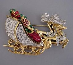 """SWAROVSKI clear rhinestone pave and enamel Christmas sleigh full of packages brooch in hand polished gold plated setting, Pictured in Mary Morrison's """"Christmas Jewelry"""" page Jewelry Christmas Tree, Jewelry Tree, Christmas Jewelry, Antique Jewelry, Vintage Jewelry, Swarovski Brooch, Vintage Rhinestone, Vintage Brooches, Stud Earrings"""