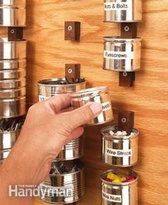 DIY Garage Organization: Set aside a few months worth of fruit and coffee cans and put these cannery rows to work organizing all of the small hardware. All you need are some homemade wood clips and a chunk of plywood screwed to a wall.