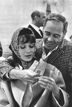 "The actress Audrey Hepburn photographed with her husband Mel Ferrer (actor, dialogue coach and film director) on set of her new movie ""My Fair Lady"", at the Warner Brothers Burbank Studios in Burbank,..."