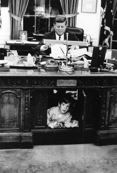 President John F. Kennedy and John F. Kennedy Jr. in the Oval Office.