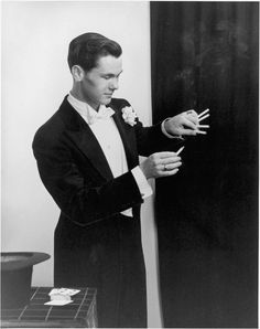 A young Johnny Carson performing cigarette magic.