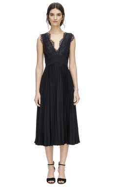 This beautiful cocktail dress has timeless appeal. V-front and back lace bodice with scalloped edging, defined waist and a fluid, accordion pleat skirt.