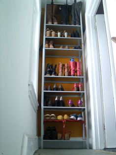 shoe storage made out of two Hyllis shelves from Ikea $15.00.  Not terribly good looking, but not labour intensive either.