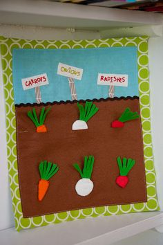 Veggie garden quiet book page.  (Read info on this on how she'd do it different next time.  Good points. Green ribbon would work for the tops.)